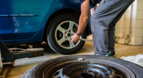 New tire being installed on a vehicle